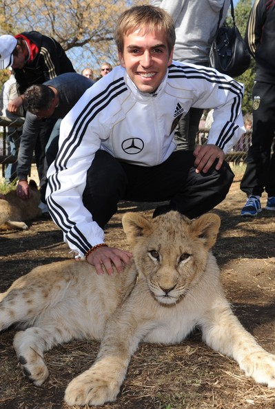 Philipp Lahm Philipp Lahm of the German National Team strokes a lion cup during a visit at the Lion Park on June 25, 2010 in Lanseria, South Africa.