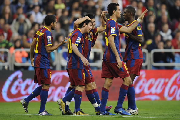 Lionel Messi Lionel Messi of Barcelona (2ndL) celebrates with his teammates after scoring his side first goal during the La Liga match between Real Zaragoza and Barcelona at La Romareda on October 23, 2010 in Zaragoza, Spain.