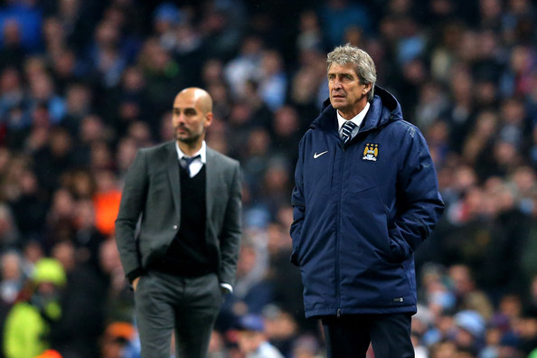 (R-L) Manuel Pellegrini the manager of Manchester City and Josep Guardiola the head coach of Bayern Muenchen look on during the UEFA Champions League Group E match between Manchester City and FC Bayern Muenchen at the Etihad Stadium on November 25, 2014 in Manchester, United Kingdom.