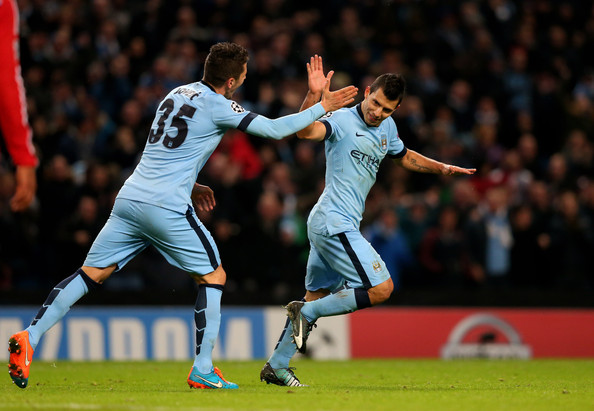 Sergio Aguero of Manchester City celebrates with teammate Stevan Jovetic #35 of Manchester City after scoring his team's second goal during the UEFA Champions League Group E match between Manchester City and FC Bayern Muenchen at the Etihad Stadium on November 25, 2014 in Manchester, United Kingdom.