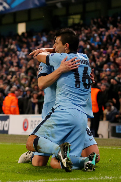 Sergio Aguero #16 of Manchester City celebrates with teammate Samir Nasri after scoring his team's third and matchwinning goal during the UEFA Champions League Group E match between Manchester City and FC Bayern Muenchen at the Etihad Stadium on November 25, 2014 in Manchester, United Kingdom.