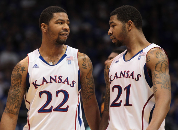 Markieff Morris Marcus Morris #22 and Markieff Morris #21 of the Kansas Jayhawks talk during the game against the USC Trojans on December 18, 2010 at Allen Fieldhouse in Lawrence, Kansas.