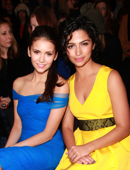 (L-R) Actresses Nina Dobrev and Camila Alves attend the Monique Lhuillier Fall 2012 fashion show during Mercedes-Benz Fashion Week at The Theatre at Lincoln Center on February 11, 2012 in New York City.