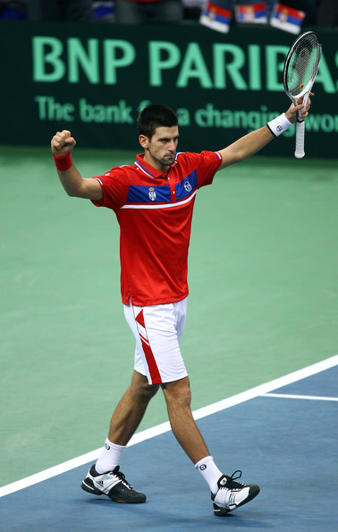 Novak Djokovic Novak Djokovic of Serbia celebrates at match point after defeating Gael Monfils of France during day three of the Davis Cup Tennis Final at the Begrade Arena on December 5, 2010 in Belgrade, Serbia.