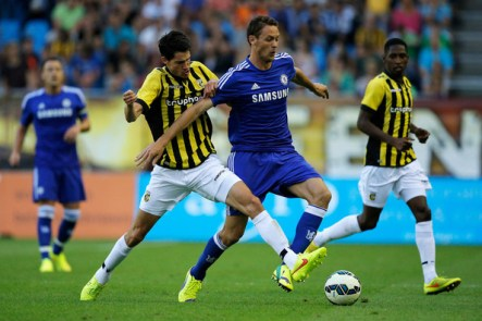 Marko Vejinovic of Vitesse and Nemanja Matic of Chelsea battle for the ball during the pre season friendly match between Vitesse Arnhem and Chelsea at the Gelredome Stadium on July 30, 2014 in Arnhem, Netherlands.