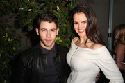 (L-R) Singer/Song Writer Nick Jonas and Shauna Brook attend Z Zegna & GQ Celebrate The New Z Zegna Collection Hosted By Nick Jonas at Philymack Studios on February 5, 2015 in West Hollywood, California.