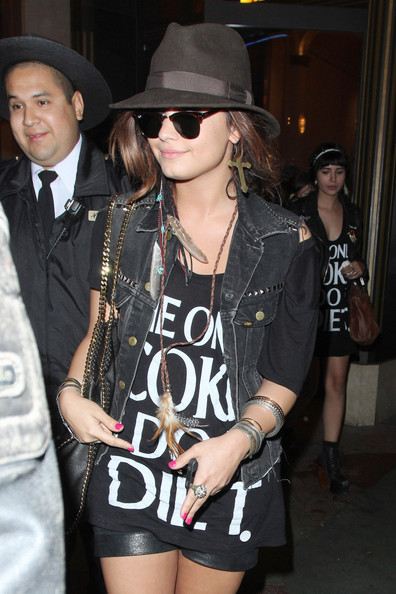 Demi Lovato Dressed in an anti-drug t-shirt Demi Lovato enjoys a night out with friends at the movies at The Grove in Los Angeles.