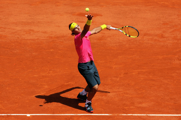 Rafael Nadal Rafael Nadal of Spain serves during his Men's Singles First Round match against Marcos Daniel of Brazil at the French Open on May 25, 2009 in Paris, France.  (Photo by Matthew Stockman/Getty Images) *** Local Caption *** Rafael Nadal