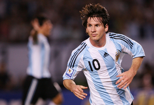 Lionel Messi Lionel Messi of Argentina celebrates the first goal during the 2010 FIFA World Cup South African qualifier match between Argentina and Venezuela at River Plate Stadium on March 28, 2009 in Buenos Aires, Argentina. (Photo by Photogamma/Getty Images) *** Local Caption *** Lionel Messi