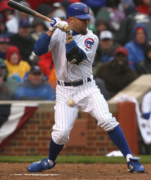 Reed Johnson #9 of the Chicago Cubs is hit by a pitch from Ubaldo Jimenez of the Colorado Rockies during the Opening Day game on April 13, 2009 at Wrigley Field in Chicago, Illinois. (Photo by Jonathan Daniel/Getty Images) *** Local Caption *** Reed Johnson