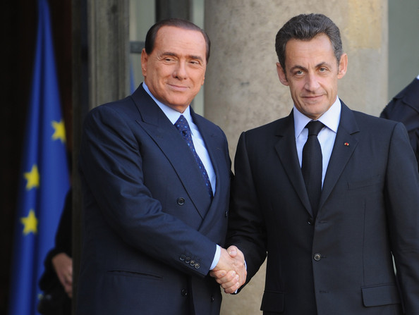 Nicolas Sarkozy Italien President Silvio Berlusconi (L) is greeted by French President Nicolas Sarkozy (R) in the courtyard of the Elysee Palace on October 4, 2008 in Paris, France. European Leaders from France, Italy, Britain and Germany hold a meeting in Paris to discuss the economic crisis in Europe.