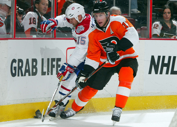 Jeff Carter #17 of the Philadelphia Flyers defends against Glen Metropolit #15 of the Montreal Canadiens on February 27, 2009 at Wachovia Center in Philadelphia, Pennsylvania. The Habs defeated the Flyers 4-3 in overtime.  (Photo by Jim McIsaac/Getty Images) *** Local Caption *** Jeff Carter;Glen Metropolit
