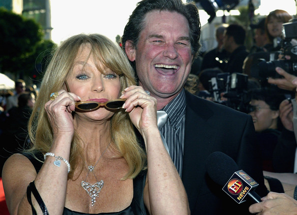 Kurt Russell Actress Goldie Hawn and husband actor Kurt Russell talk to a reporter as they attend the film premiere of the romantic comedy 'Raising Helen' on May 26, 2004 at the El Capitan Theatre, in Hollywood, California.