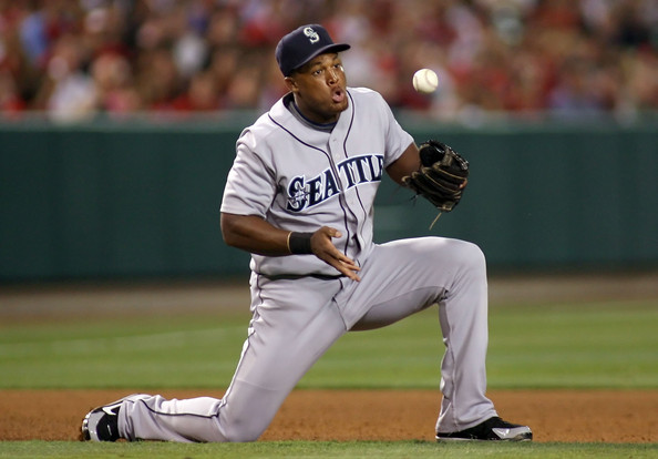 Infielder Adrian Beltre #29 of the Seattle Mariners bobbles the ball before fielding a ground ball out against the Los Angeles Angels of Anaheim during the game at Angel Stadium on August 12, 2008 in Anaheim, California. The Angels defeated the Mariners 7-3.