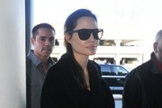 Actress and busy mom Angelina Jolie departing on a flight at LAX airport in Los Angeles, California on January 23, 2015. Jolie has been busy as of late promoting the film 'Unbroken,' which she produced and directed.