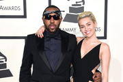 Producer Mike Will Made It (L) and singer Miley Cyrus attend The 57th Annual GRAMMY Awards at the STAPLES Center on February 8, 2015 in Los Angeles, California.