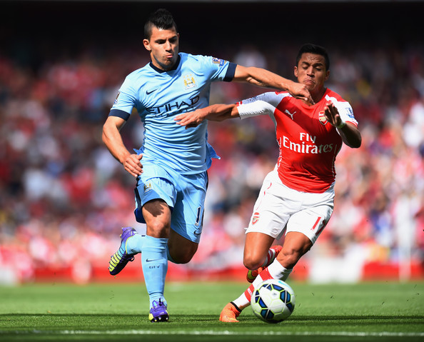 Sergio Aguero of Manchester City and Alexis Sanchez of Arsenal battle for the ball during the Barclays Premier League match between Arsenal and Manchester City at Emirates Stadium on September 13, 2014 in London, England.
