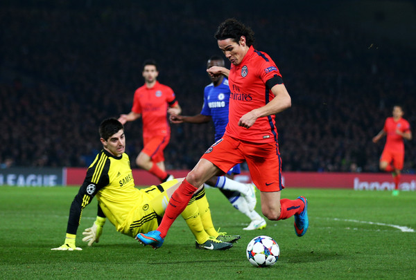Edinson Cavani of PSG rounds goalkeeper Thibaut Courtois of Chelsea during the UEFA Champions League Round of 16, second leg match between Chelsea and Paris Saint-Germain at Stamford Bridge on March 11, 2015 in London, England.