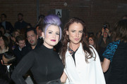 Kelly Osbourne (L) and Juliette Lewis attend the Christian Siriano Fashion Show at ArtBeam on February 14, 2015 in New York City.