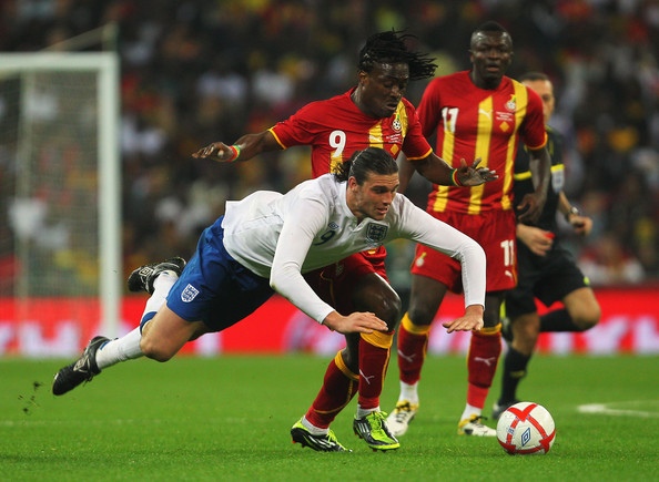Derek Boateng Derek Boateng of Ghana (C) tackles Andy Carroll of England during the international friendly match between England and Ghana at Wembley Stadium on March 29, 2011 in London, England.