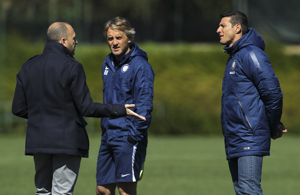 (L-R) Sporting Director of FC Internazionale Milano Piero Ausilio, FC Internazionale Milano coach Roberto Mancini and Vice President of FC Internazionale Milano Javier Zanetti during a FC Internazionale training session at the club's training ground on April 7, 2015 in Appiano Gentile Como, Italy.