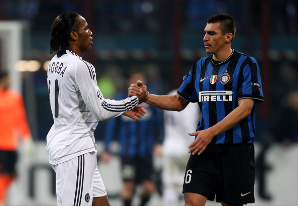 Lucio of Inter Milan (R) shakes hands with Didier Drogba of Chelsea at the end of the UEFA Champions League Round of 16 first leg match between Inter Milan and Chelsea at the San Siro Stadium on February 24, 2010 in Milan, Italy.