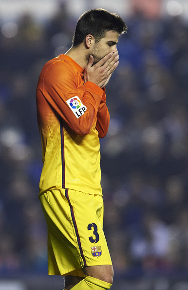 Gerard Pique of Barcelona reacts as he fails to score during the la Liga match between Levante UD and FC Barcelona at Ciutat de Valencia on November 25, 2012 in Valencia, Spain.