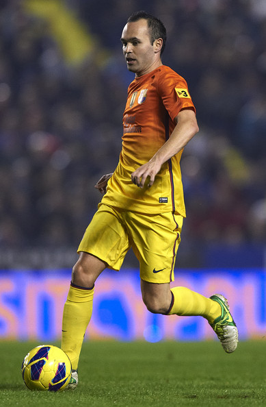 Andres Iniesta of Barcelona runs with the ball during the La Liga match between Levante UD and FC Barcelona at Ciutat de Valencia on November 25, 2012 in Valencia, Spain.