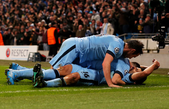 (R-L) Sergio Aguero #16 of Manchester City celebrates with teammates Samir Nasri and Frank Lampard after scoring his team's third and matchwinning goal during the UEFA Champions League Group E match between Manchester City and FC Bayern Muenchen at the Etihad Stadium on November 25, 2014 in Manchester, United Kingdom.