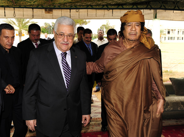 In this handout image provided by the Palestinian Press Office (PPO), Palestinian President Mahmoud Abbas (L) is greeted by Libyan leader Muammar Gaddafi (R) on September 4, 2010 in Libya, Tripoli. Abbas is in Libya following a trip to the U.S. for Mideast peace talks in which he met in a State Department room alone with Israeli Prime Minister Benjamin Netanyahu.