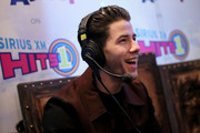 Singer-songwriter Nick Jonas attends Hits 1's The Morning Mash Up Broadcast from the SiriusXM Studios on February 10, 2015 in Los Angeles, California.