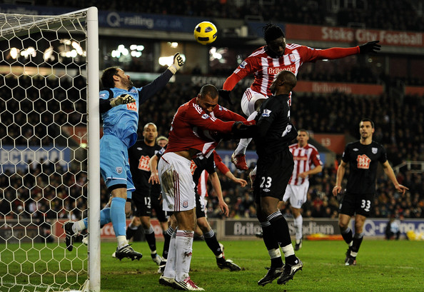 Scott Carson of West Bromwich Albion punches clear under pressure from John Carew and Kenwyne Jones  (R) of Stoke Cityduring the Barclays Premier League match between Stoke City and West Bromwich Albion at The Britannia Stadium on February 28, 2011 in Stoke on Trent, England.