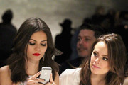 Victoria Justice (L) and stylist Madison Guest attend the Rebecca Minkoff fashion show with TRESemme during Mercedes-Benz Fashion Week Fall 2015 at The Pavilion at Lincoln Center on February 13, 2015 in New York City.