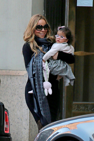 "Mariah Carey carries her baby daughter Monroe while out and about in Tribeca, NYC. Baby Monroe, looking adorable in a pair of pink glasses and carrying a stuffed bunny, has a twin brother names Moroccan and the pair are reportedly nicknamed ""Roc and Roe"" by Carey."