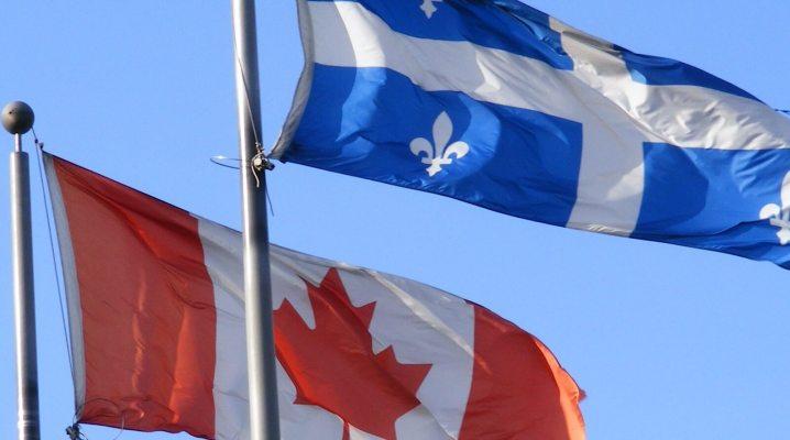 La photo représente les drapeaux du Canada et du Québec.