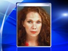 Woman intentionally hits police cruiser, dies