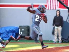 Dakwa Nichols (27) runs in for a touchdown. NC State defeated Syracuse 42-29 at Carter-Finley Stadium in Raleigh, North Carolina on November 21, 2015. (Photo by: Jerome Carpenter/WRAL Contributor)