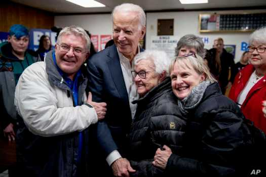 Democratic presidential candidate former Vice President Joe Biden takes a photo with members of the audience at a campaign stop…
