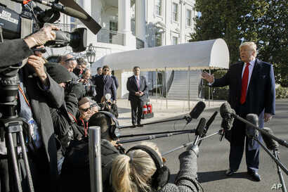 President Donald Trump speaks to the media as he leaves the White House before departing to India, Sunday, Feb. 23, 2020, in…