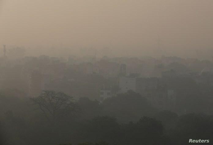 Buildings are seen shrouded in smog in New Delhi, India, Nov. 5, 2019.