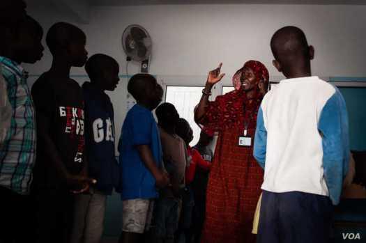 Talibés who were abused by their teachers learn the Koran from teacher Ya Seyda Fatoumata Diof at a shelter Dec. 12, 2019, in Dakar, Senegal. (Annika Hammerschlag/VOA)
