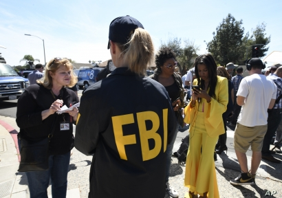 An FBI agent gives out information to members of the media outside of the Chabad of Poway Synagogue Saturday, April 27, 2019,…