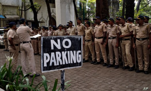 A police officer gives instructions in Mumbai, Saturday, Nov. 9, 2019. ndia's security forces were on high alert ahead of the…