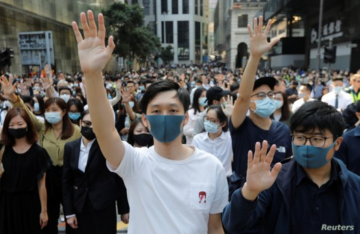 Demonstrators raise their hands as they attend a protest at the Central District in Hong Kong, China, November 15, 2019…