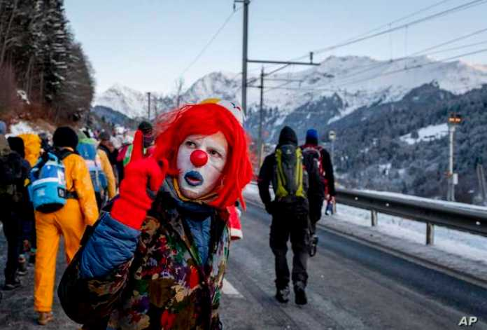 A man dressed as a clown is part of hundreds of climate protesters who are on a three-day  protest march from Landquart to…