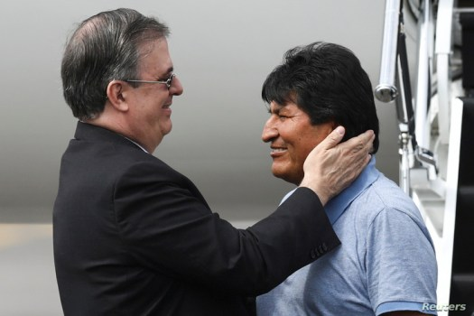 Bolivia's ousted President Evo Morales is welcomed by Mexico's Foreign Minister Marcelo Ebrard during his arrival to take asylum in Mexico, in Mexico City, Mexico, Nov. 12, 2019.