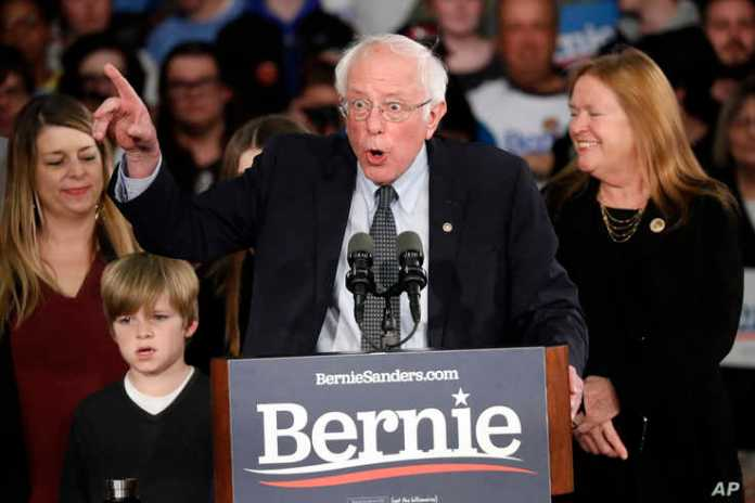 Democratic presidential candidate Sen. Bernie Sanders, I-Vt., with his wife Jane O'Meara Sanders, speaks to supporters at a…