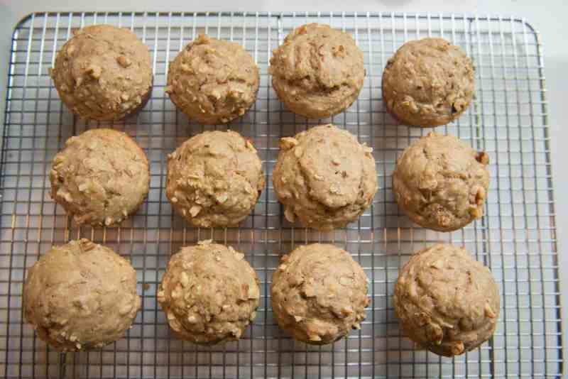 baked healthy banana oat muffins cooling on a wire rack