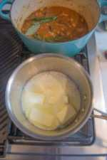 butter and garlic simmering in a sauce pot on the stove