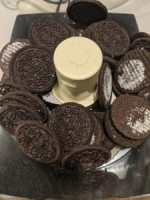 Oreo cookies with filling removed sitting inside a food processor ready to be pulsed
